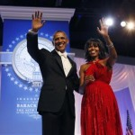 U.S. President Barack Obama and first lady Michelle Obama wave to attendees at the Inaugural Ball in Washington